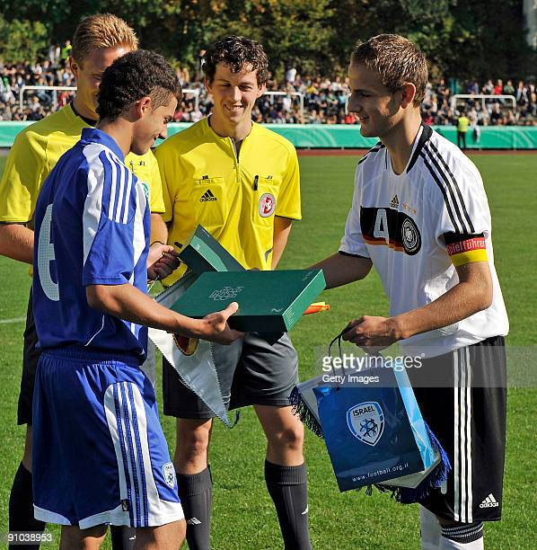 Nils Zander of Germany shakes hands with Yardan Sagic of Israel prior the U17 friendly international match between Germany and Israel at the Belkaw...