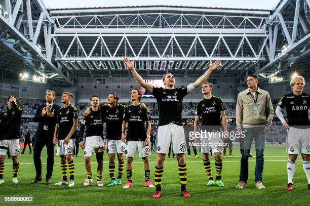 NilsEric Johansson captain of AIK celebrates together with teammates after the victory in the Allsvenskan match between Djurgardens IF and AIK at...