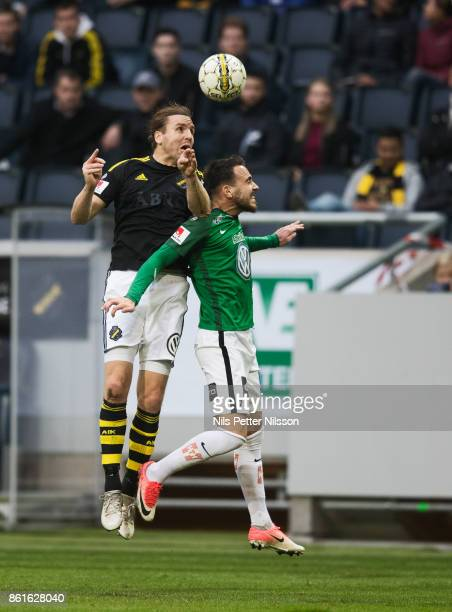 NilsEric Johansson of AIK and Dzenis Kozica of Jonkopings Sodra competes for the ball during the Allsvenskan match between AIK and Jonkopings Sodra...
