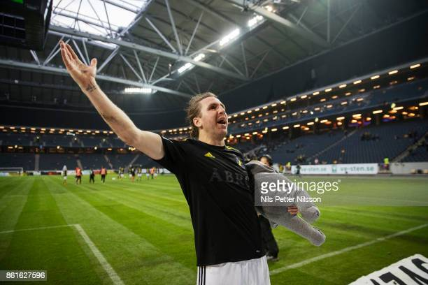 NilsEric Johansson of AIK celebrates after the victory with his son Kobey Dale during the Allsvenskan match between AIK and Jonkopings Sodra IF at...