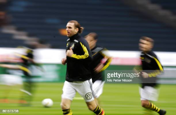 NilsEric Johansson of AIK during warmup ahead of the Allsvenskan match between AIK and Jonkopings Sodra IF at Friends Arena on October 15 2017 in...