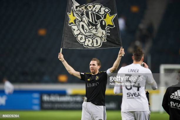 NilsEric Johansson of AIK holds up a banner from AIK Ultras Nord after the Allsvenskan match between AIK and IF Elfsborg at Friends Arena on October...