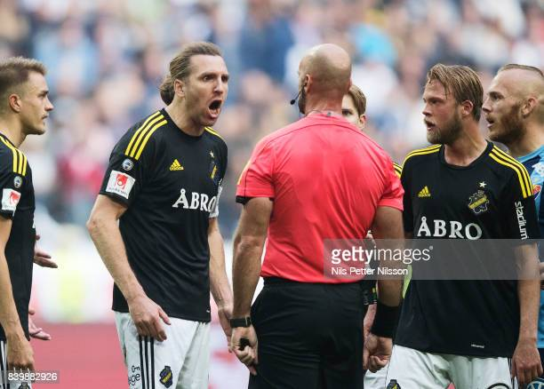 NilsEric Johansson of AIK in an argument with Stefan Johannesson referee during the Allsvenskan match between AIK and Djurgardens IF at Friends arena...
