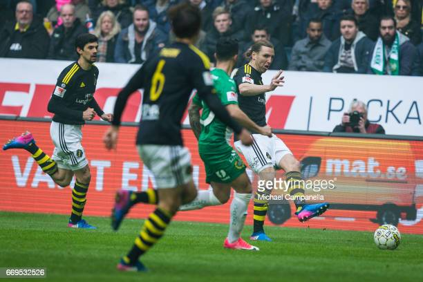 NilsEric Johansson of AIK looks to make pass as Jiloan Hamad of Hammarby IF closes in during an Allsvenskan match between AIK and Hammarby IF at...