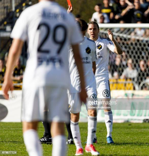 NilsEric Johansson of AIK receives a red card during the Allsvenskan match between Halmstad BK and AIK at Orjans Vall on May 6 2017 in Halmstad Sweden