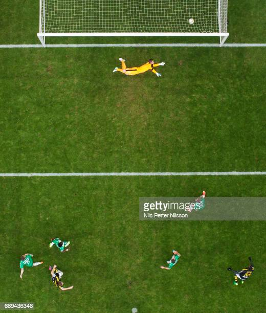NilsEric Johansson of AIK scores the opening goal to 10 during the Allsvenskan match between AIK and Hammarby IF at Friends arena on April 17 2017 in...