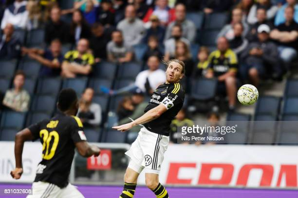 NilsEric Johansson of AIK shoots a header during the Allsvenskan match between AIK and Athletic FC Eskilstura at Friends arena on August 13 2017 in...
