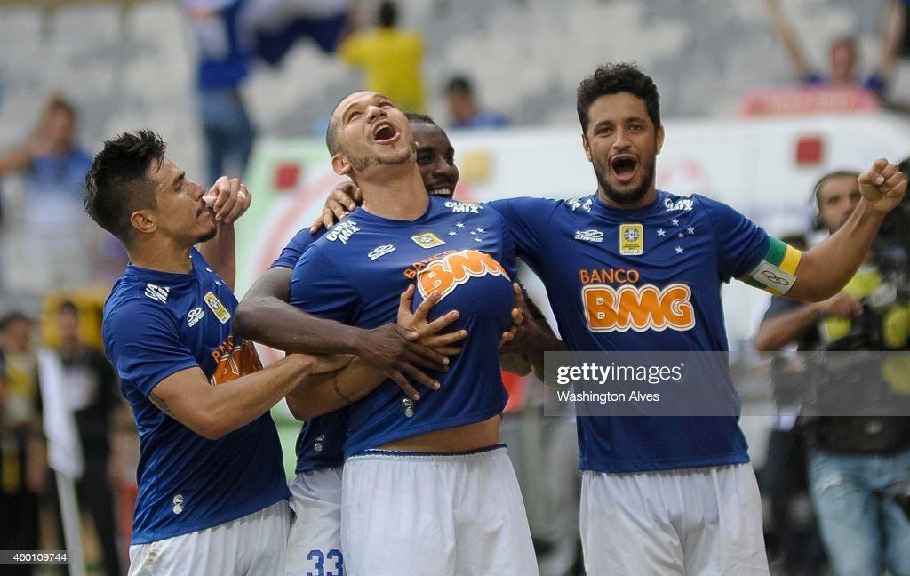 Nilton of Cruzeiro celebrates a scored goal against Fluminense during a match between Cruzeiro and Fluminense as part of Brasileirao Series A 2014 at...