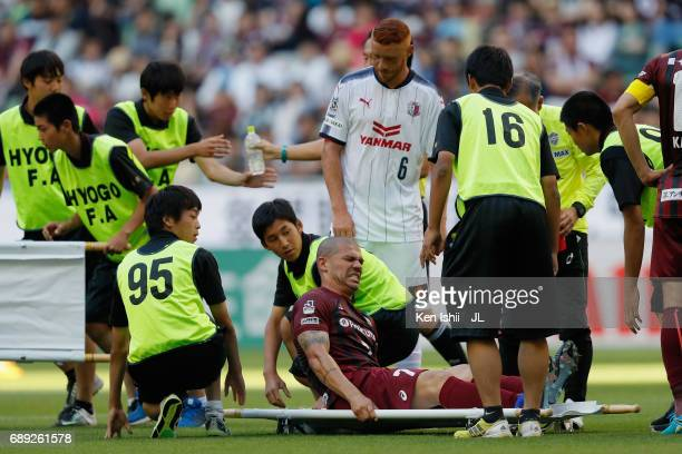 Nilton of Vissel Kobe is taken off by a stretcher after the collision with Kenyu Sugimoto of Cerezo Osaka during the JLeague J1 match between Vissel...