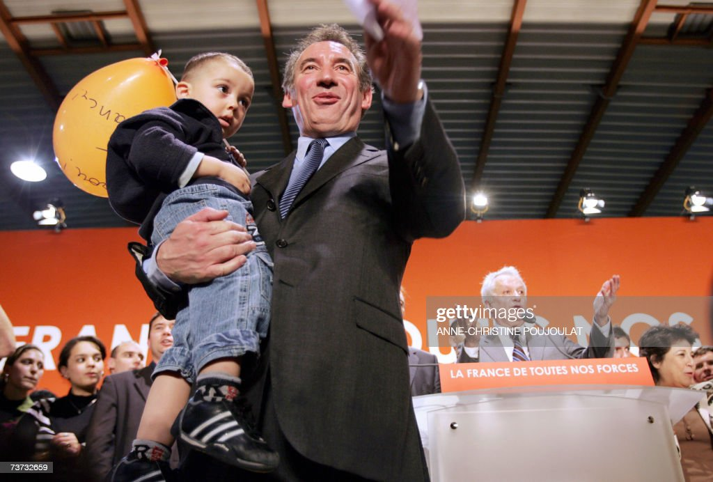 President of the French centrist party Union for the French Democracy (UDF) and presidential candidate Francois Bayrou holds during a meeting as part of his campaign, 28 march 2007 in Nimes, south eastern France. AFP PHOTO ANNE-CHRISTINE POUJOULAT