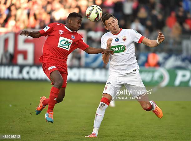 Nimes' French defender Jeremy Cordoval vies with Monaco's Argentinian midfielder Lucas Ocampos during the French Cup football match Nimes vs Monaco...