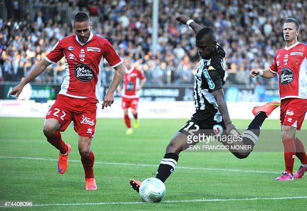 Nimes' French defender Kevin Renaut vies for the ball with Angers'Guinean midfielder Abdoul Razzagui Camara during the French L2 football match...