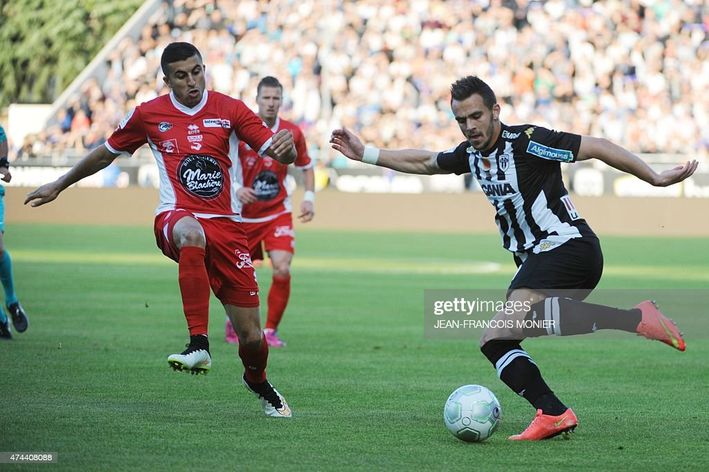 Nimes' French forward Riad Nouri vies for the ball with Angers' French forward Sacha Clemence during the French L2 football match between Angers and...