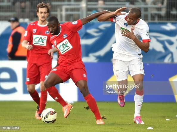 Nimes's French forward Anthony Koura vies with Monaco's Fabio Tavares during the French Cup football match Nîmes vs Monaco on January 04 2015 at the...