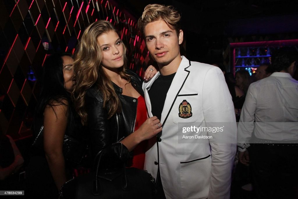 <a gi-track='captionPersonalityLinkClicked' href=/galleries/search?phrase=Nina+Agdal&family=editorial&specificpeople=7574783 ng-click='$event.stopPropagation()'>Nina Agdal</a> and Christian Acosta attend Spring Fling at Wall at W Hotel on March 13, 2014 in Miami Beach, Florida.