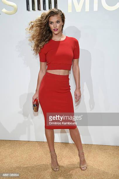 Nina Agdal attends the new Gold Collection fragrance launch hosted by Michael Kors featuring Duran Duran at Top of The Standard Hotel on September 13...