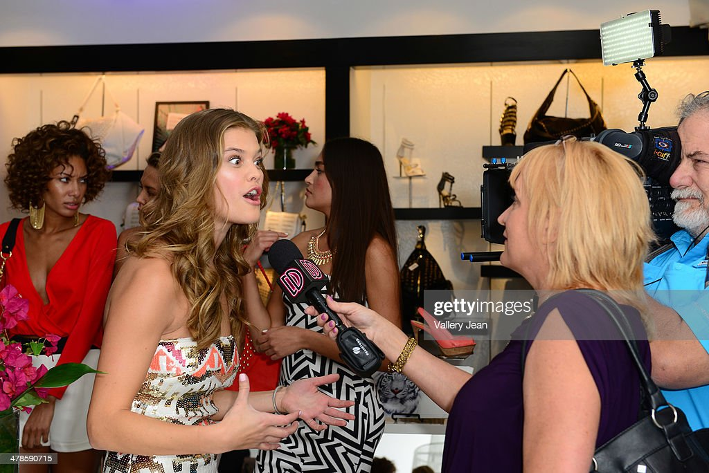 <a gi-track='captionPersonalityLinkClicked' href=/galleries/search?phrase=Nina+Agdal&family=editorial&specificpeople=7574783 ng-click='$event.stopPropagation()'>Nina Agdal</a> meets and greets fans at Bebe store on March 13, 2014 in Miami Beach, Florida.