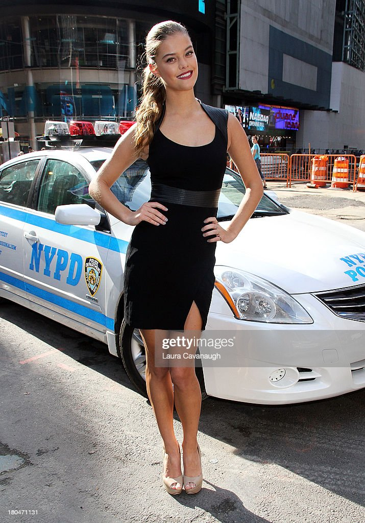 <a gi-track='captionPersonalityLinkClicked' href=/galleries/search?phrase=Nina+Agdal&family=editorial&specificpeople=7574783 ng-click='$event.stopPropagation()'>Nina Agdal</a> poses after the opening bell at NASDAQ Market Site on September 13, 2013 in New York City.