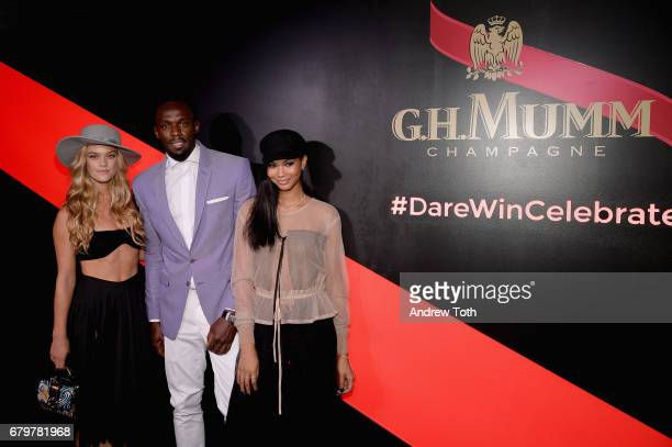 Nina Agdal Usain Bolt and Chanel Iman attend GH Mumm and Usain Bolt's Toast to the Kentucky Derby on May 6 2017 in New York City