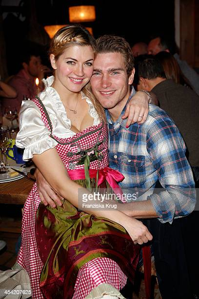 Nina Bott and Benjamin Baarz attend the Dorfstadl Evening Tirol Cross Mountain 2013 on December 07 2013 in Innsbruck Austria