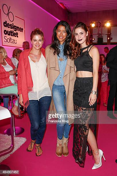 Nina Bott Rebecca Mir and Lena MeyerLandrut attend the Late Night Shopping Designer Outlet Soltau on August 28 2014 in Soltau Germany