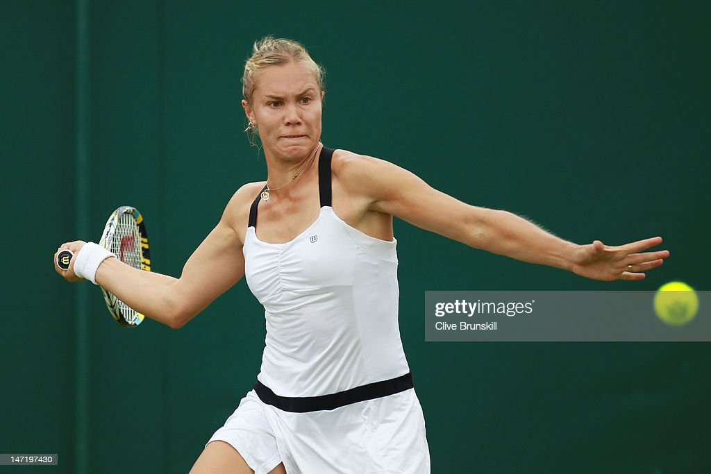 <a gi-track='captionPersonalityLinkClicked' href=/galleries/search?phrase=Nina+Bratchikova&family=editorial&specificpeople=6992687 ng-click='$event.stopPropagation()'>Nina Bratchikova</a> of Russia eyes the ball during her Ladies' singles first round match against Alize Cornet of France on day three of the Wimbledon Lawn Tennis Championships at the All England Lawn Tennis and Croquet Club on June 27, 2012 in London, England.