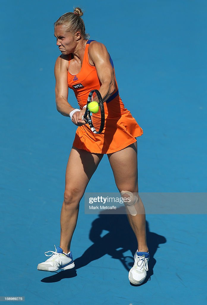 <a gi-track='captionPersonalityLinkClicked' href=/galleries/search?phrase=Nina+Bratchikova&family=editorial&specificpeople=6992687 ng-click='$event.stopPropagation()'>Nina Bratchikova</a> of Russia plays a backhand in her qualifying singles match with Sasha Jones of Australia during day two of the Hobart International at Domain Tennis Centre on January 5, 2013 in Hobart, Australia.