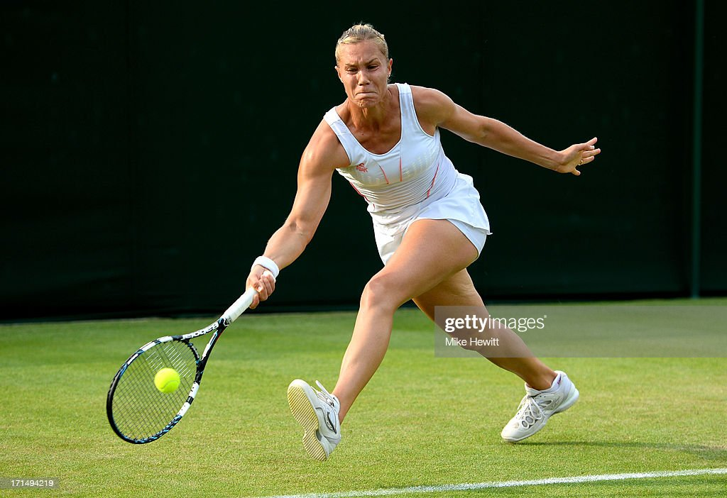 <a gi-track='captionPersonalityLinkClicked' href=/galleries/search?phrase=Nina+Bratchikova&family=editorial&specificpeople=6992687 ng-click='$event.stopPropagation()'>Nina Bratchikova</a> of Russia plays a forehand during her Ladies' Singles first round match against Annika Beck of Germany on day two of the Wimbledon Lawn Tennis Championships at the All England Lawn Tennis and Croquet Club on June 25, 2013 in London, England.