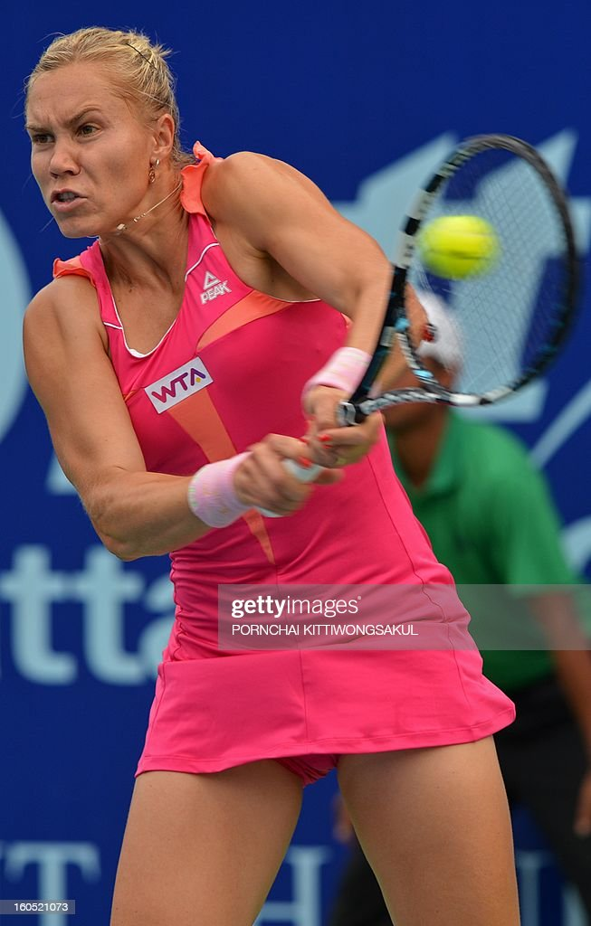 Nina Bratchikova of Russia plays a shot against Sabine Lisicki of Germany during the tennis women's singles semi-final round of the WTA Pattaya Open tennis tournament in Pattaya resort on February 2, 2013.