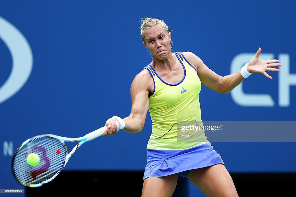 <a gi-track='captionPersonalityLinkClicked' href=/galleries/search?phrase=Nina+Bratchikova&family=editorial&specificpeople=6992687 ng-click='$event.stopPropagation()'>Nina Bratchikova</a> of Russia returns a shot against Agnieszka Radwanska of Poland during their women's singles first round match on Day Two of the 2012 US Open at USTA Billie Jean King National Tennis Center on August 28, 2012 in the Flushing neigborhood of the Queens borough of New York City.