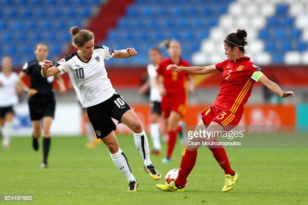 Nina Burger of Austria and Marta Torrejon of Spain battle for possession during the UEFA Women's Euro 2017 Quarter Final match between Austria and...