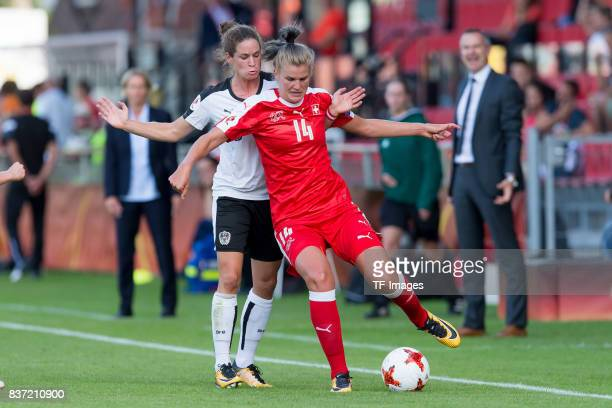 Nina Burger of Austria and Rahel Kiwic of Switzerland battle for the ball during the Group C match between Austria and Switzerland during the UEFA...