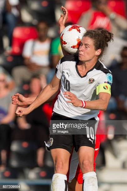 Nina Burger of Austria battle for the ball during the Group C match between Austria and Switzerland during the UEFA Women's Euro 2017 at Stadion De...