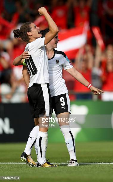 Nina Burger of Austria celebrate with her team mate Sarah Zadrazil after she scores the opening goal during the Group C match between Austria and...