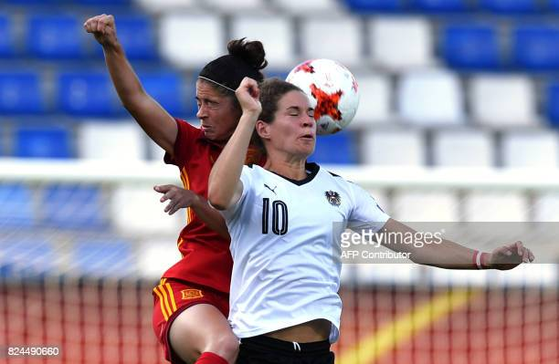 Nina Burger of Austria vies with Marta Torrejon of Spain during the UEFA Women's Euro 2017 quarterfinal football match between Austria and Spain at...