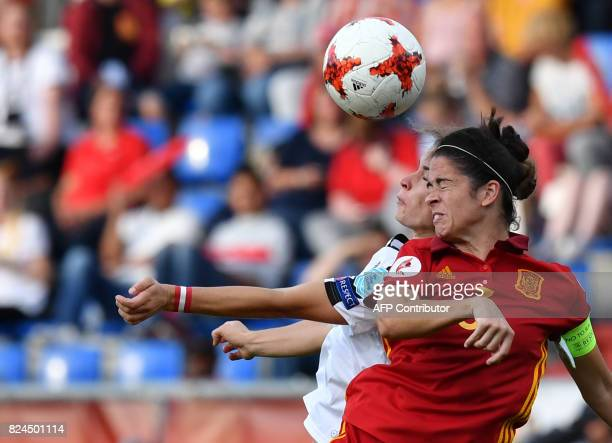 Nina Burger of Austria vies with Marta Torrejon of Spain during the UEFA Womens Euro 2017 football match between Austria and Spain at the Willem II...