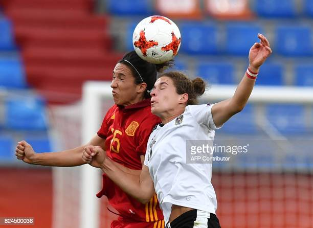 Nina Burger of Austria vies with Silvia Meseguer of Spain during the UEFA Womens Euro 2017 football match between Austria and Spain at the Willem II...