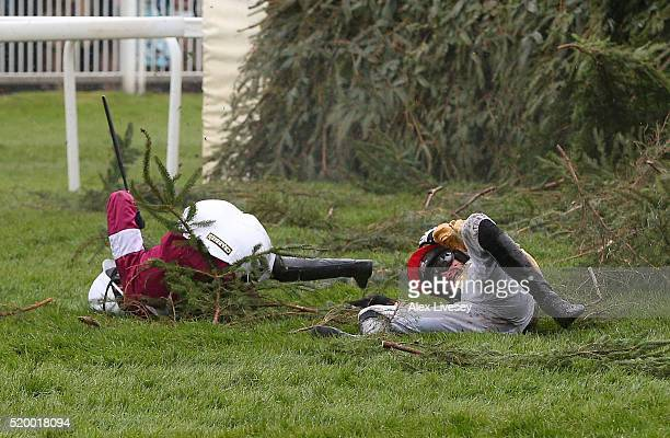 Nina Carberry and PW Mullins lie on the ground after falling from their mounts at The Chair fence during Crabbie's Grand National Steeple Chase at...