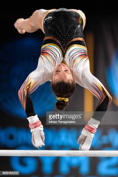 Nina Derwael of Belgium competes on the uneven bars during the women's individual allaround final of the Artistic Gymnastics World Championships on...