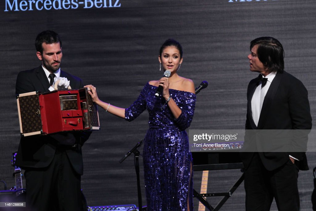 Nina Dobrev and Alan Siegel attend amfAR's Cinema Against AIDS auction at Hotel Du Cap on May 24, 2012 in Antibes, France.