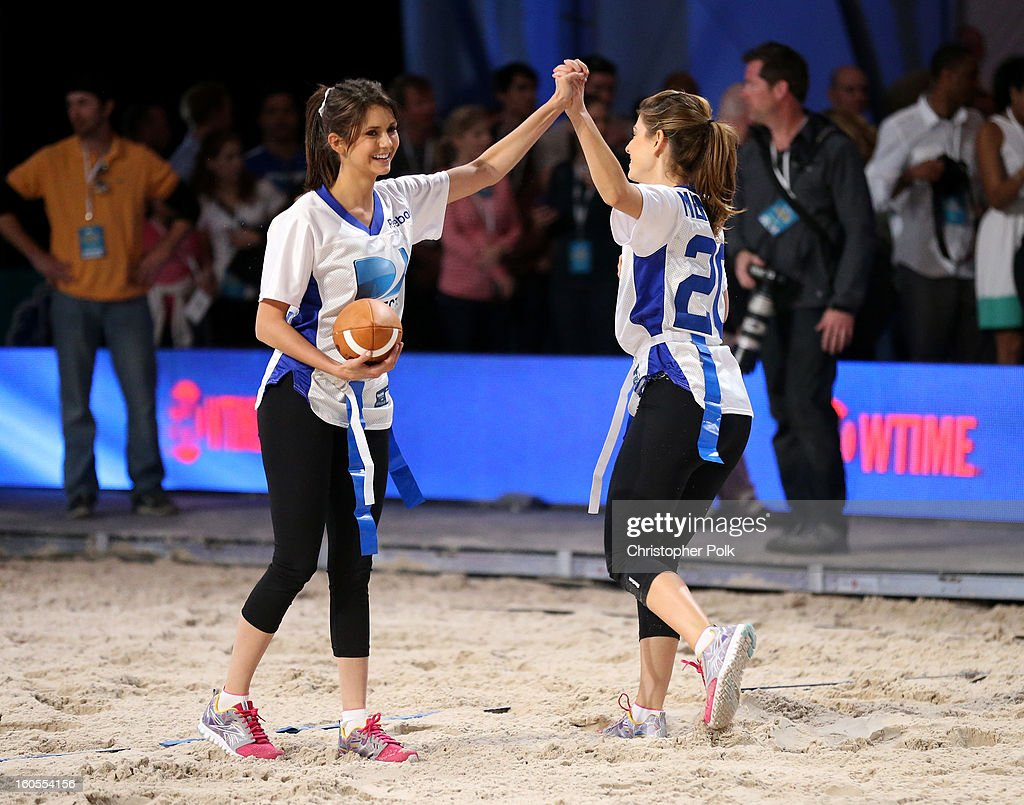 Nina Dobrev and Maria Menounos attends DIRECTV'S Seventh Annual Celebrity Beach Bowl at DTV SuperFan Stadium at Mardi Gras World on February 2, 2013 in New Orleans, Louisiana.