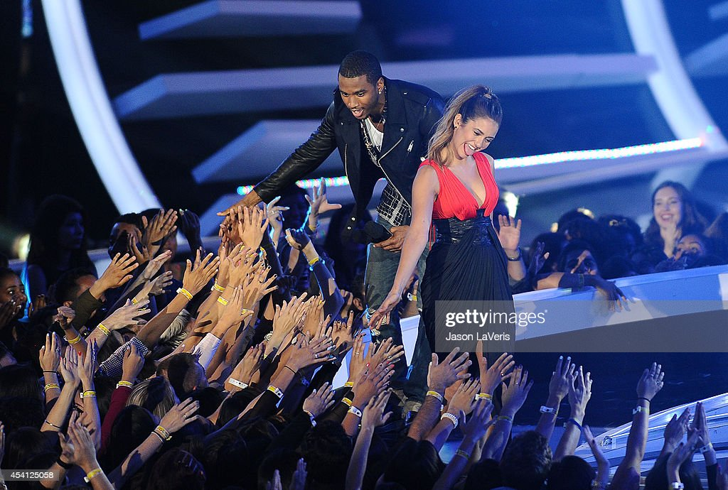 Nina Dobrev and Trey Songz onstage at the 2014 MTV Video Music Awards at The Forum on August 24, 2014 in Inglewood, California.