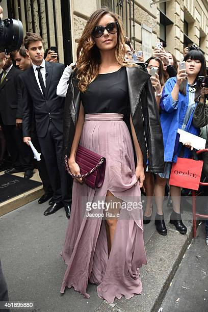 Nina Dobrev arrives to attend the Elie Saab show as part of Paris Fashion Week Haute Couture Fall/Winter 20142015 on July 9 2014 in Paris France
