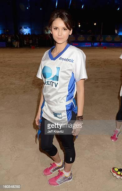 Nina Dobrev attends DIRECTV'S 7th Annual Celebrity Beach Bowl at DTV SuperFan Stadium at Mardi Gras World on February 2 2013 in New Orleans Louisiana