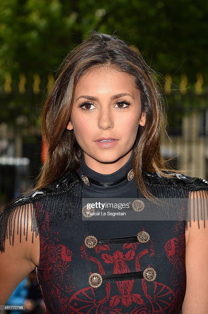 <a gi-track='captionPersonalityLinkClicked' href=/galleries/search?phrase=Nina+Dobrev&family=editorial&specificpeople=4397485 ng-click='$event.stopPropagation()'>Nina Dobrev</a> attends the Versace show as part of Paris Fashion Week - Haute Couture Fall/Winter 2014-2015 on July 6, 2014 in Paris, France.