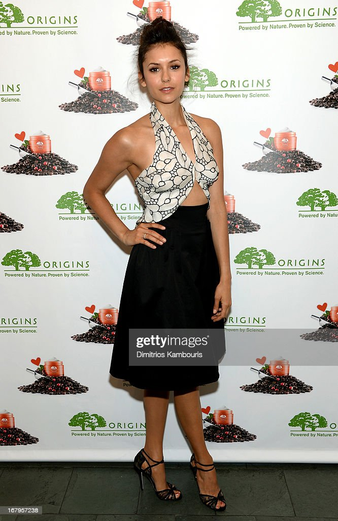<a gi-track='captionPersonalityLinkClicked' href=/galleries/search?phrase=Nina+Dobrev&family=editorial&specificpeople=4397485 ng-click='$event.stopPropagation()'>Nina Dobrev</a> launches the new Origins GinZing Energy-Boosting Moisturizer on May 3, 2013 in New York City.