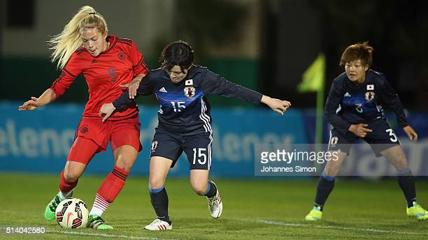Nina Ehegoetz of Germany and Mayu Sasaki of Japan fight for the ball during the women's U23 international friendly match between WU20 Germany and...