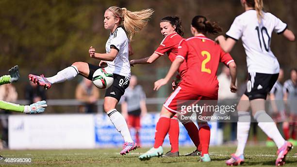 Nina Ehegoetz of Germany scores the second goal during the U19 Women's Elite Round match between U19 Belgium and U19 Germany on April 9 2015 in Forst...