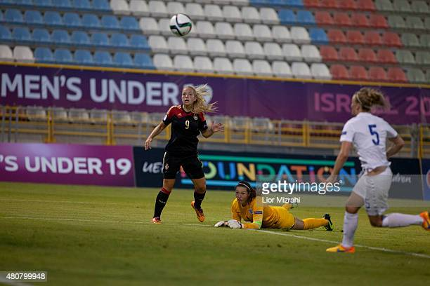 Nina Ehegotz of Germany challenges Caitlin Leach of England during the UEFA Women's Under19 European Championship group stage match between U19...