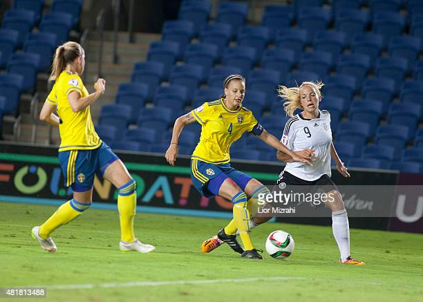 Nina Ehegotz of Germany challenges Nathalie Bjorn of Sweden during the UEFA Women's Under19 European Championship semi final between U19 Germany and...